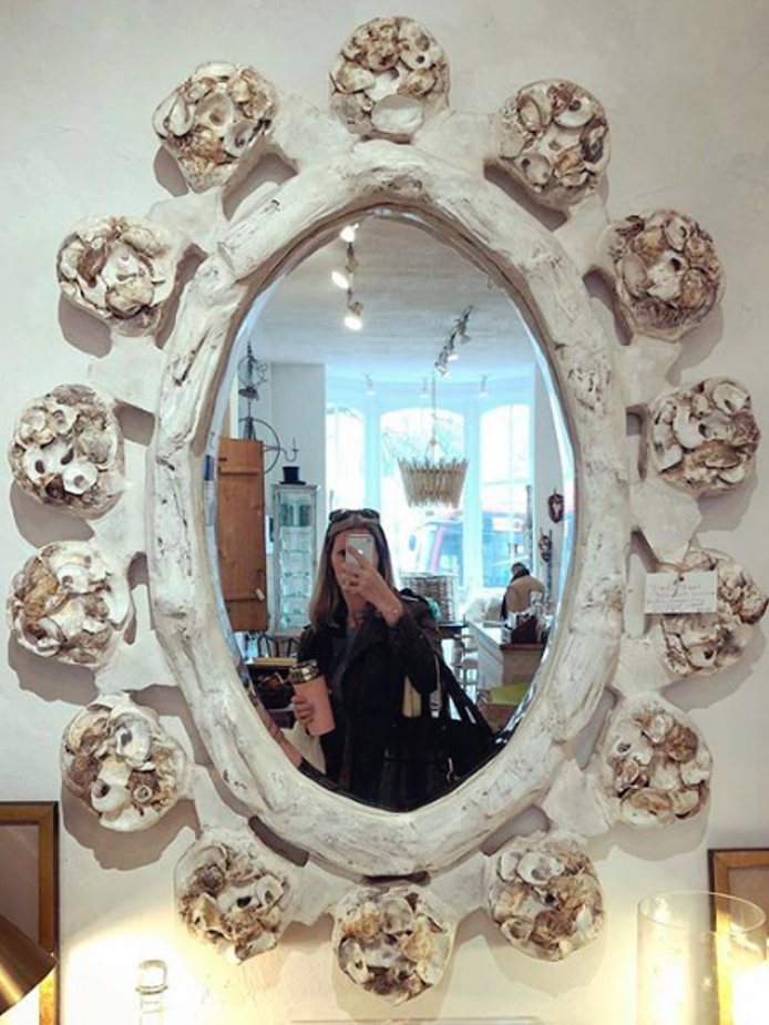 Tricia Huntley reflected in a Georgetown shop mirror